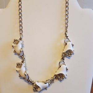 Silver toned necklace with white tulips.